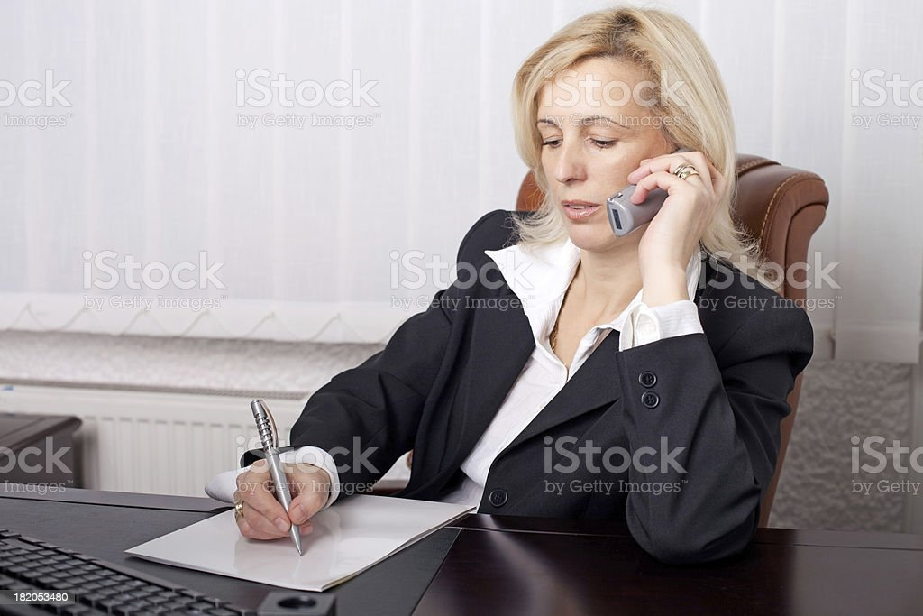 Businesswoman at the office calling by phone. royalty-free stock photo