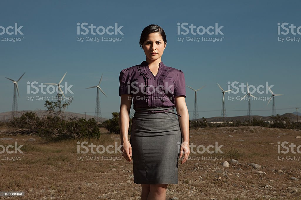Businesswoman at wind farm stock photo
