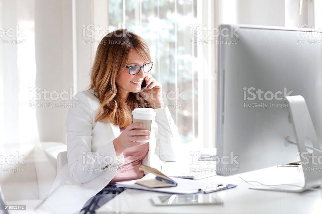 Businesswoman at work stock photo