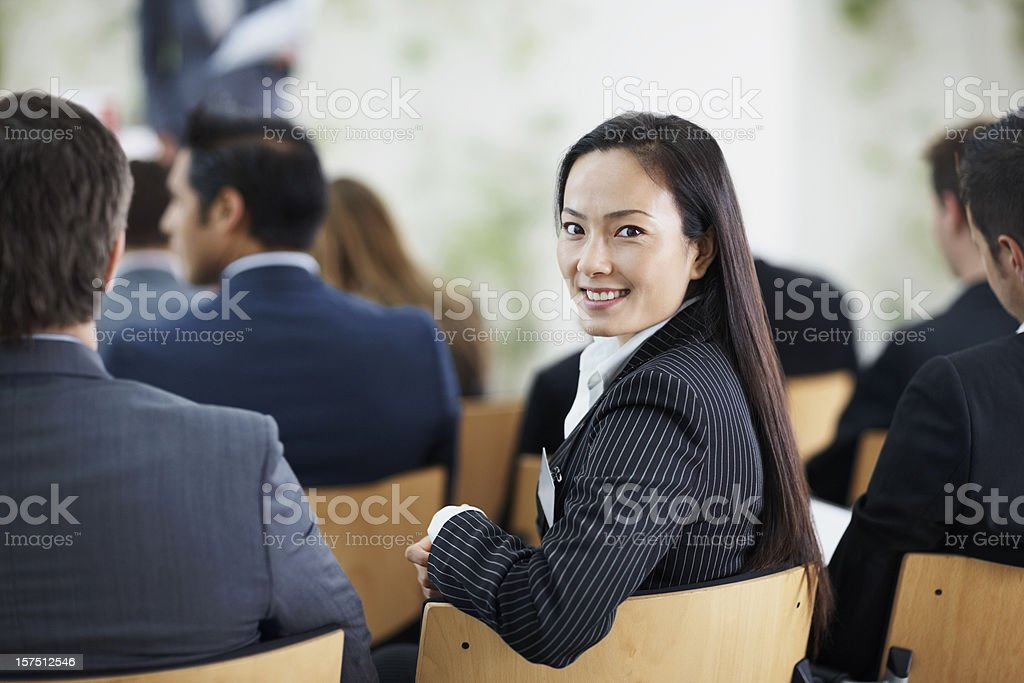 Businesswoman attending a conference royalty-free stock photo