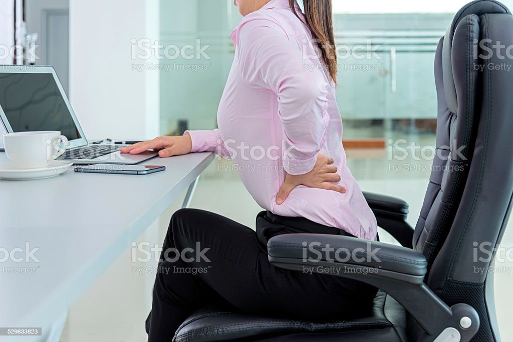 Businesswoman backache stock photo