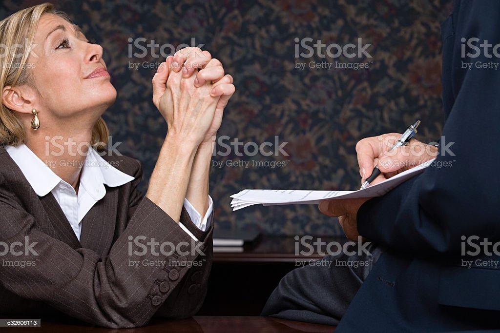 Businesswoman begging stock photo