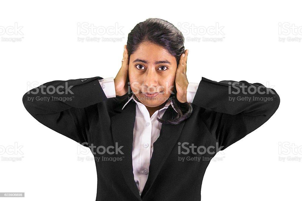 businesswoman blocking the ears stock photo