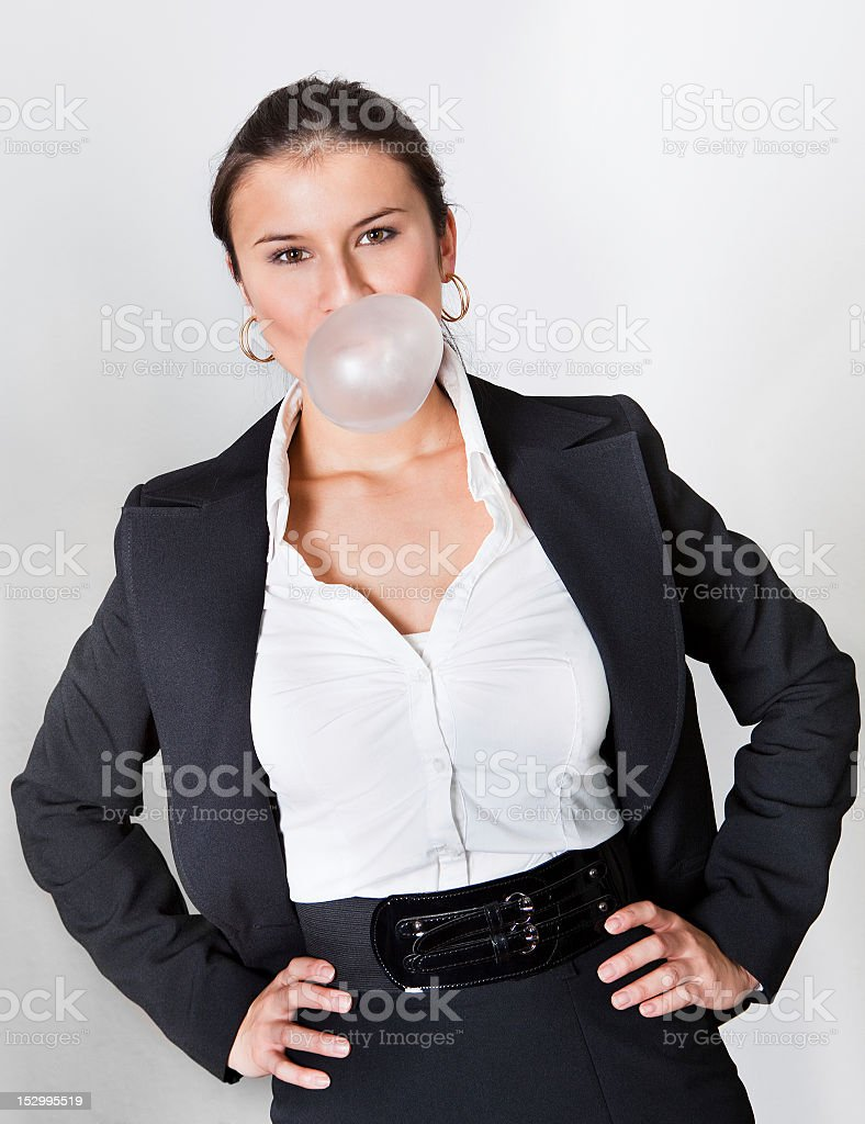 Businesswoman blowing bubblegum royalty-free stock photo