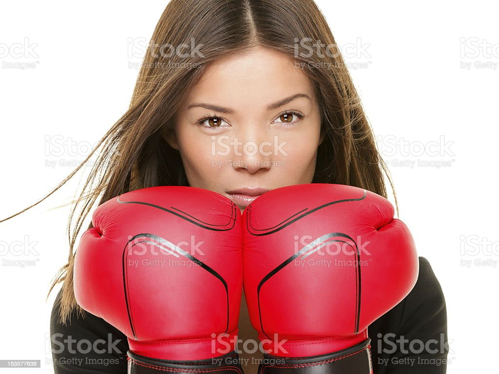 Businesswoman boxing gloves stock photo