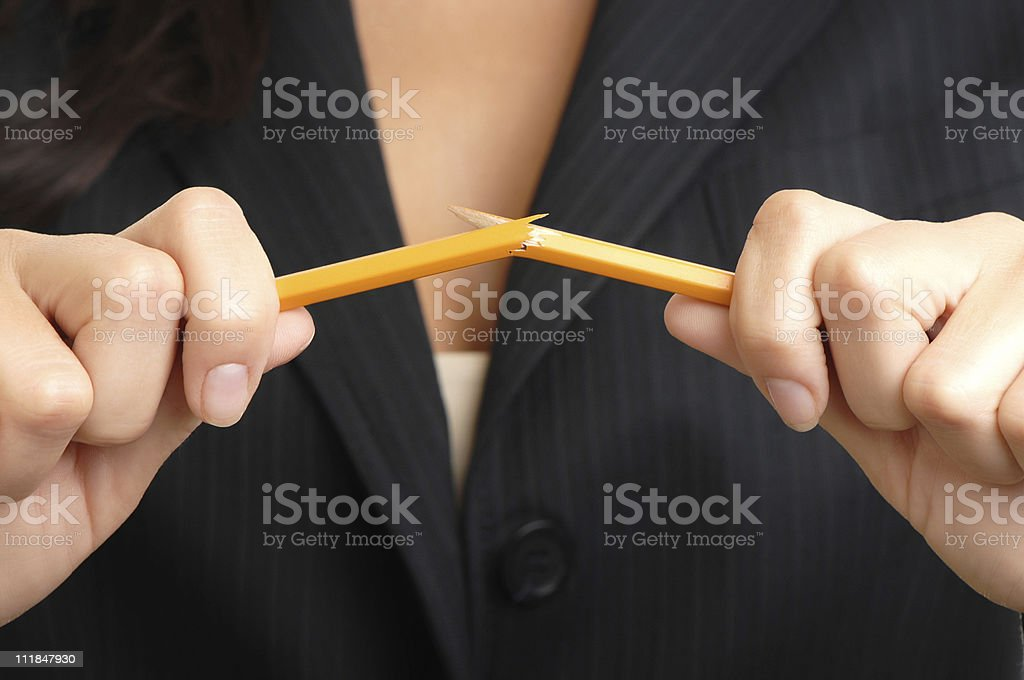 Businesswoman breaking a pencil on white royalty-free stock photo