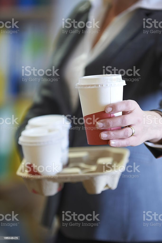 A businesswoman bringing some takeaway coffee royalty-free stock photo