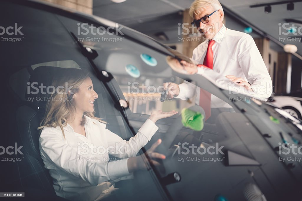 Businesswoman buying a new car stock photo