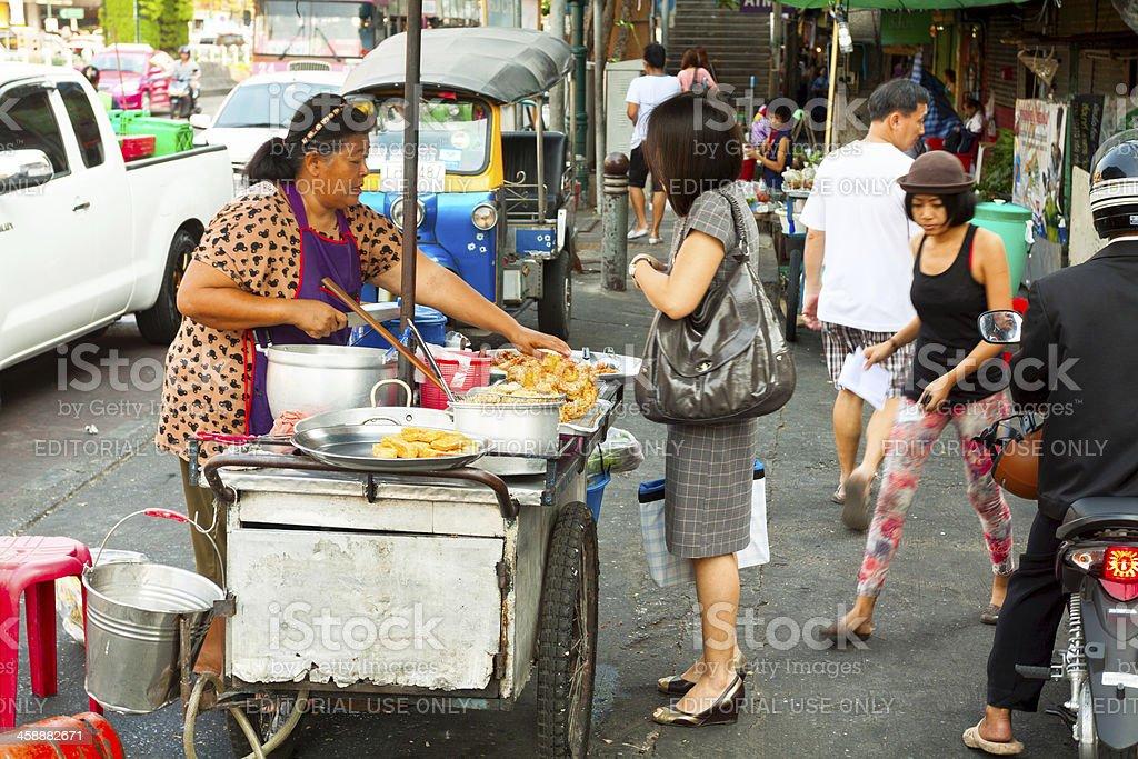 Businesswoman buys breakfast royalty-free stock photo