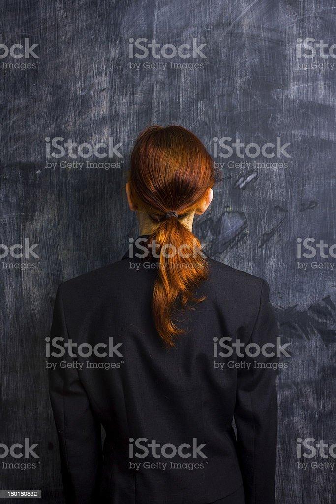 Businesswoman by blank blackboard royalty-free stock photo