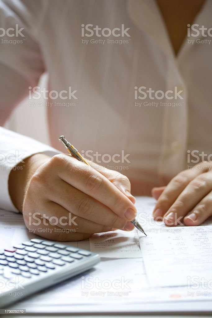 Businesswoman calculating data royalty-free stock photo