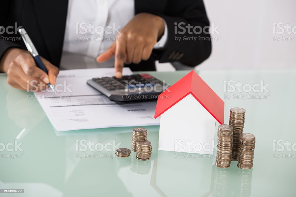 Businesswoman Calculating Invoice On Desk stock photo