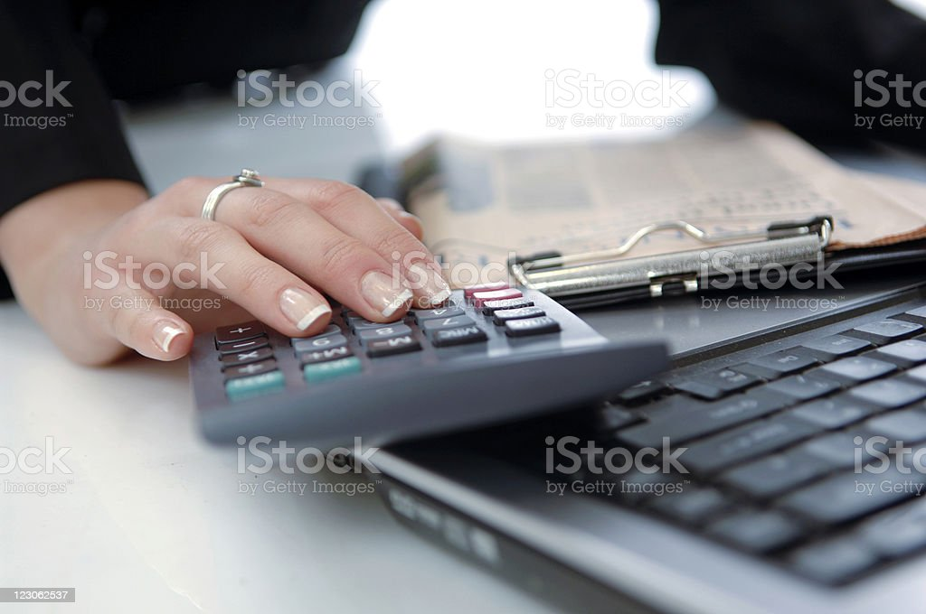 Businesswoman calculating royalty-free stock photo
