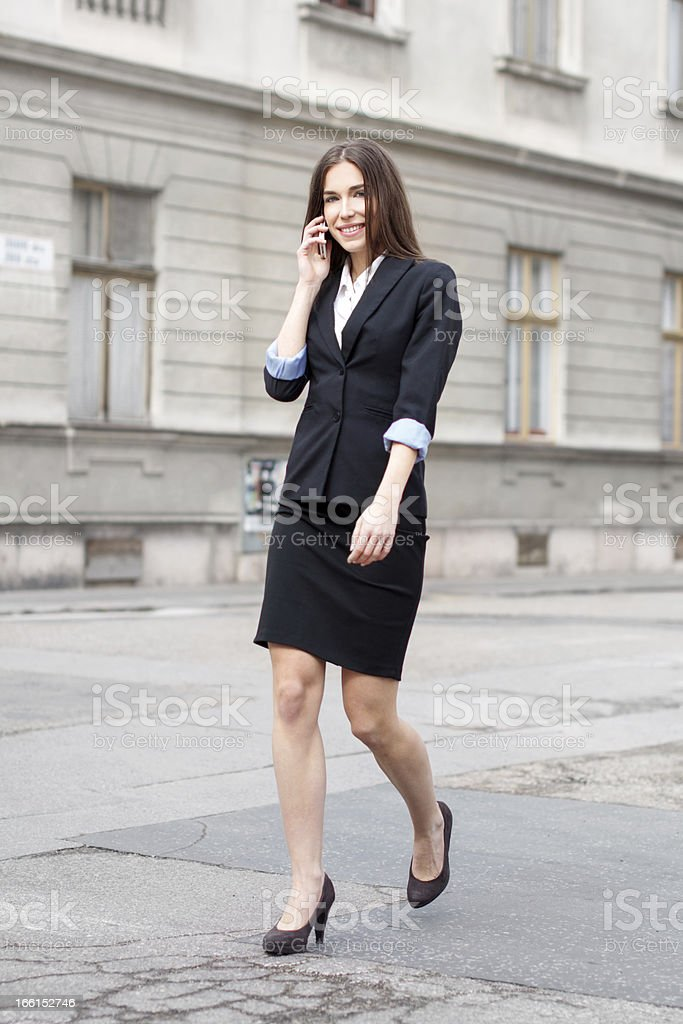 Businesswoman calling on the street royalty-free stock photo
