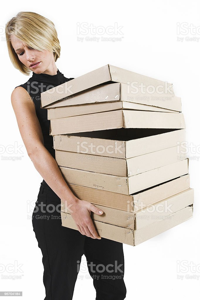 Businesswoman carrying brown boxes royalty-free stock photo