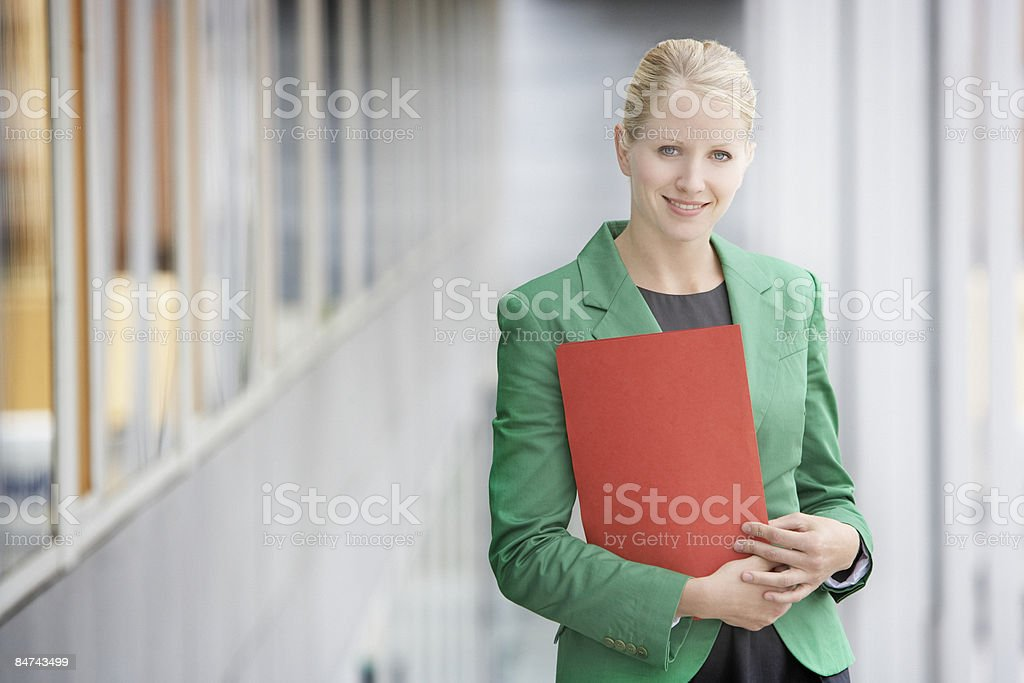 Businesswoman carrying file royalty-free stock photo