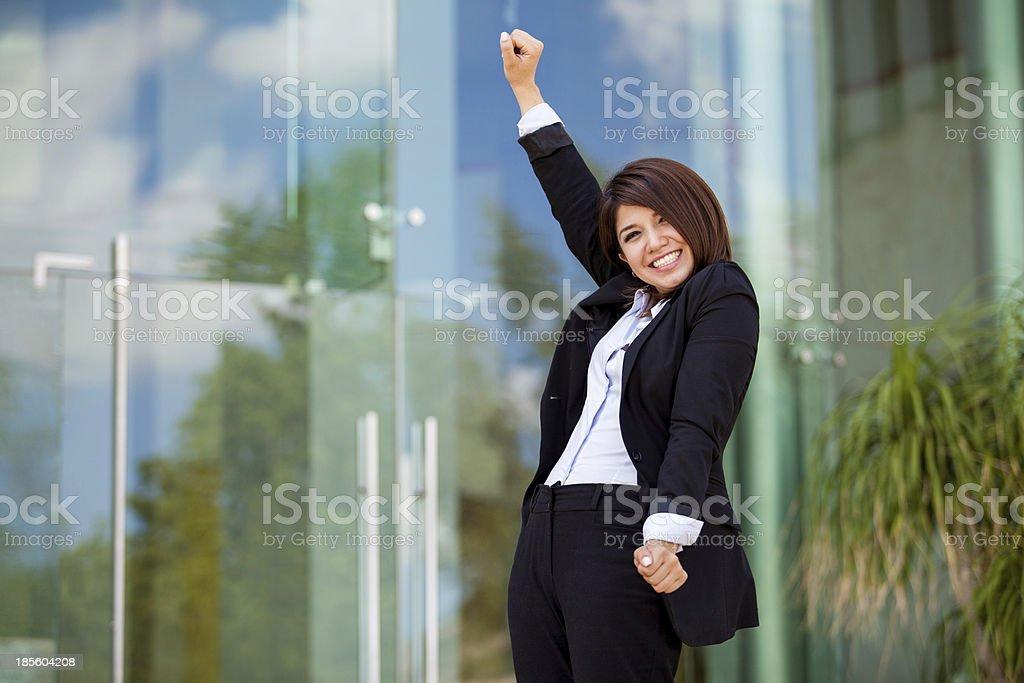 Businesswoman celebrating success royalty-free stock photo