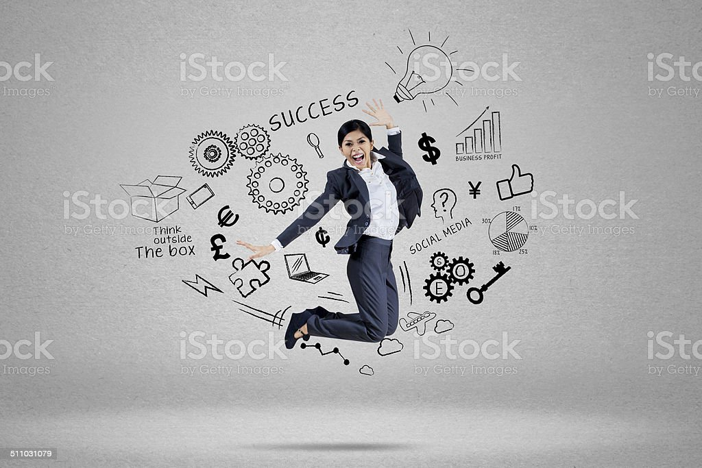 Businesswoman chasing her success 1 stock photo