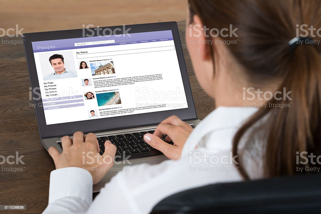Businesswoman Chatting On Social Website With Laptop stock photo