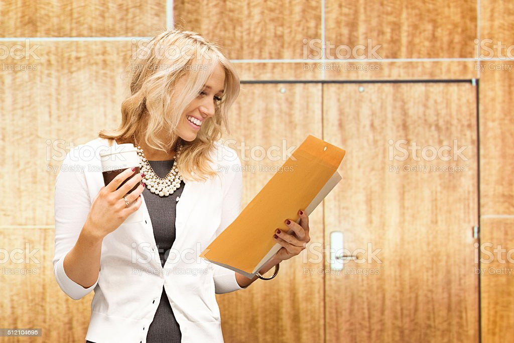 Businesswoman checking documents stock photo