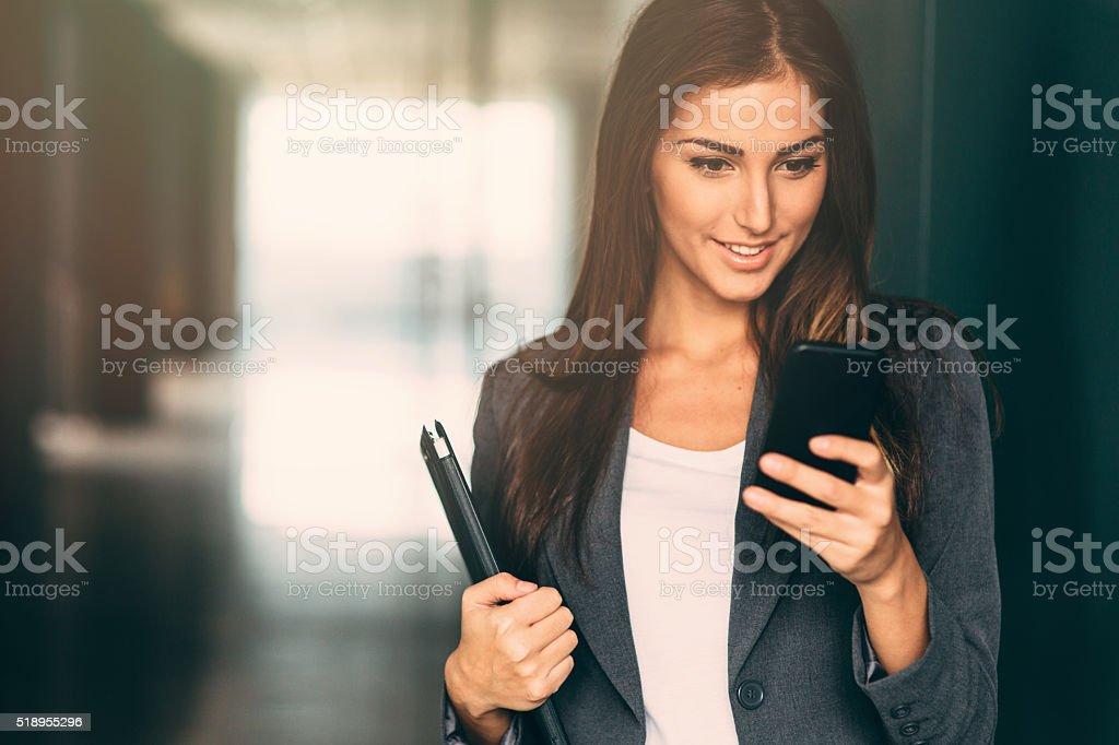 Businesswoman Checking Her Phone stock photo