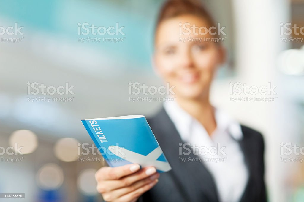 Businesswoman Checking in at the Airport stock photo