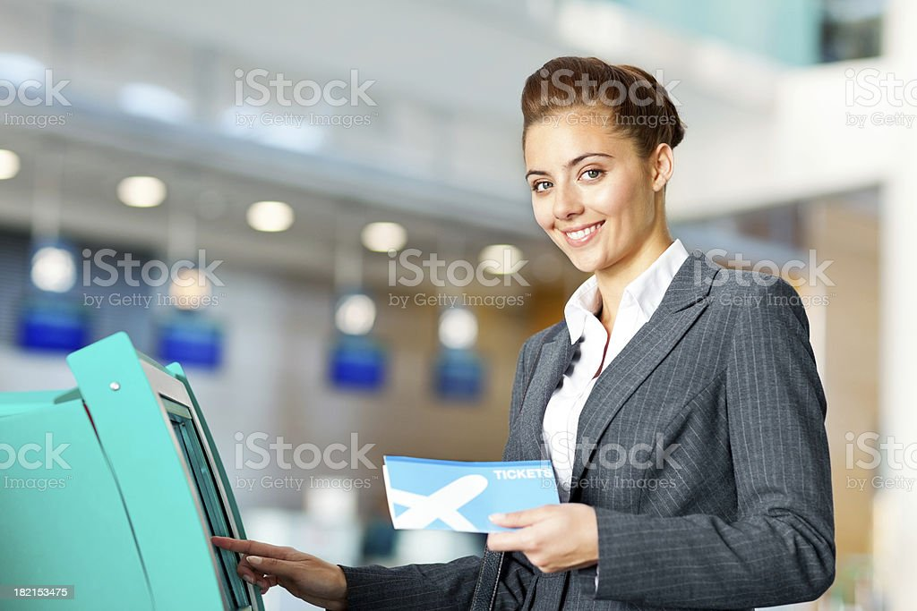 Businesswoman Checking in at the Airport royalty-free stock photo