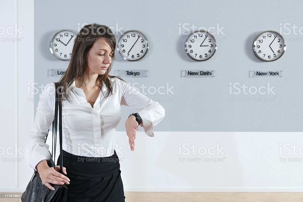 Businesswoman Checking Time royalty-free stock photo