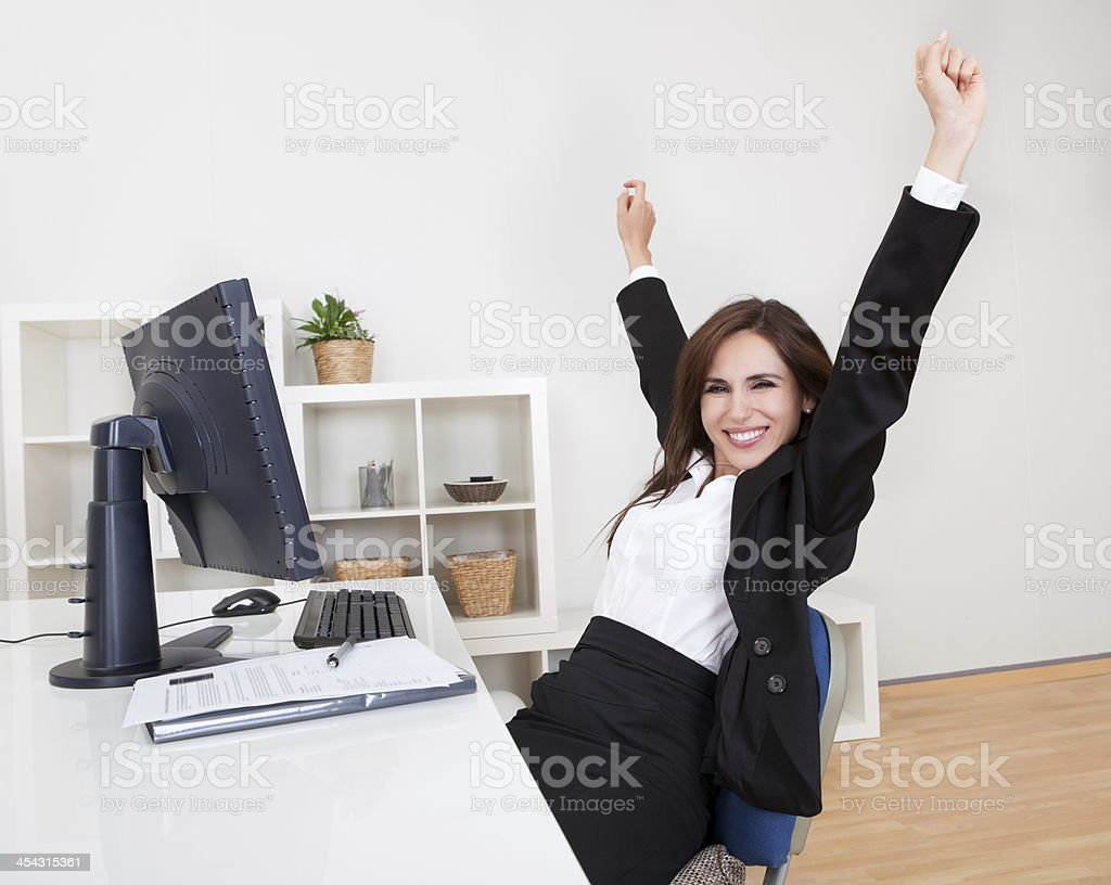Businesswoman Cheering At Desk royalty-free stock photo