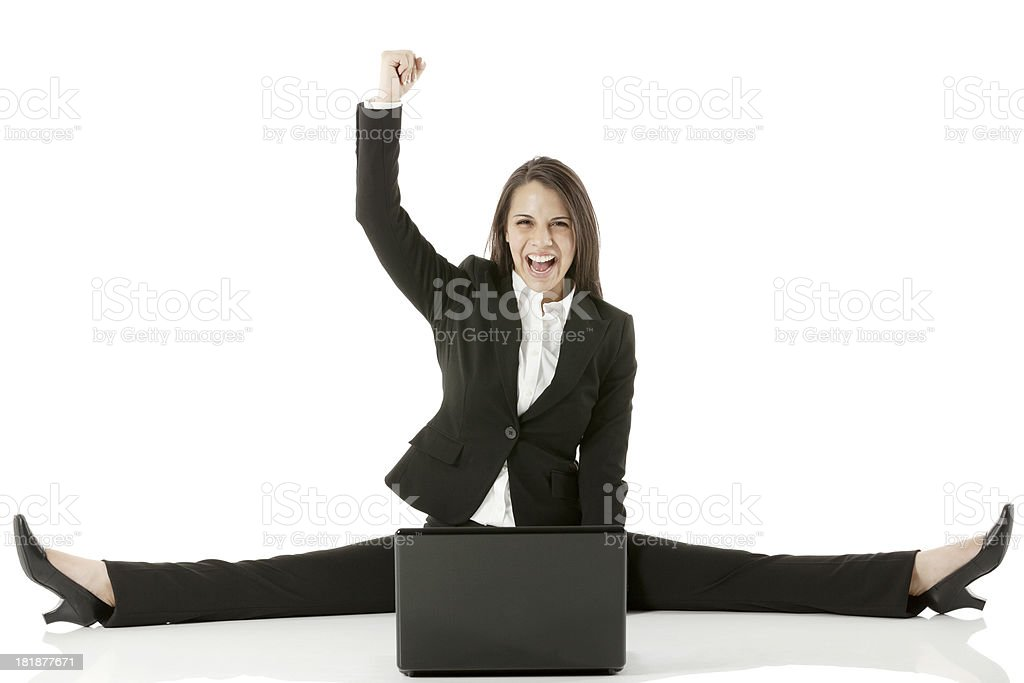 Businesswoman cheering in front of a laptop royalty-free stock photo