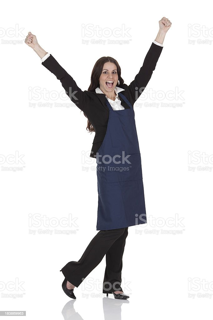 Businesswoman cheering with arms raised stock photo