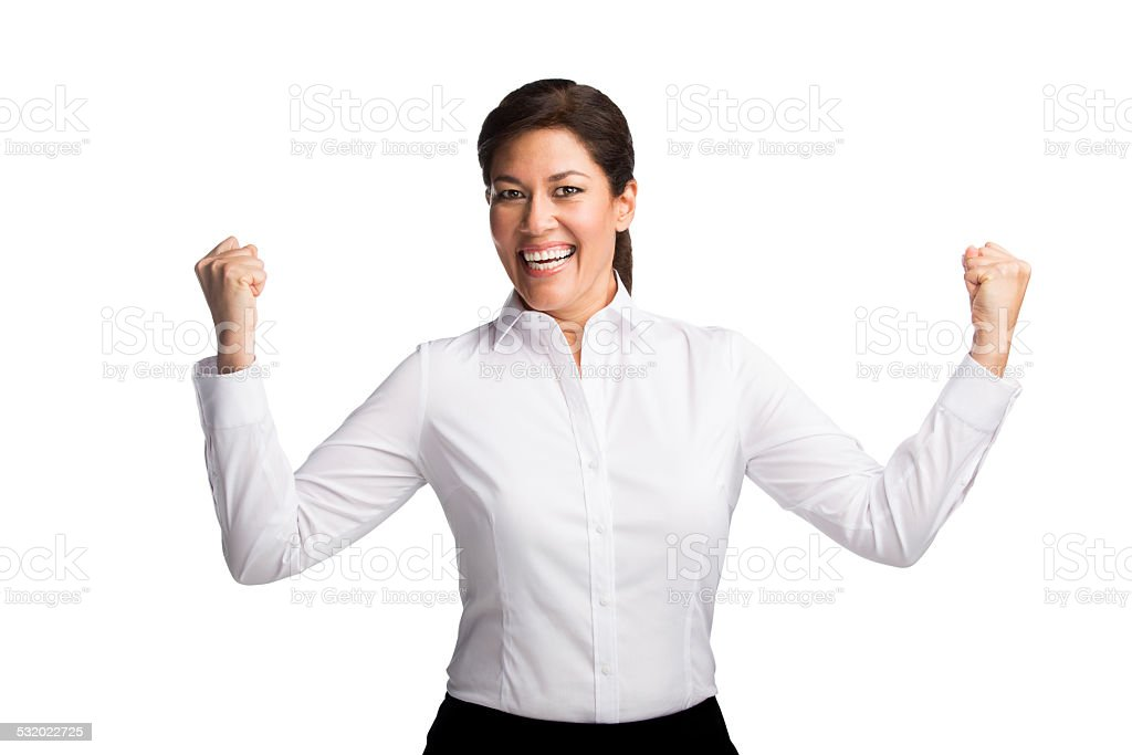 Businesswoman cheering with hands raised stock photo