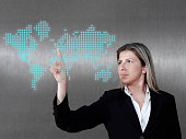 Businesswoman choosing a location from world map