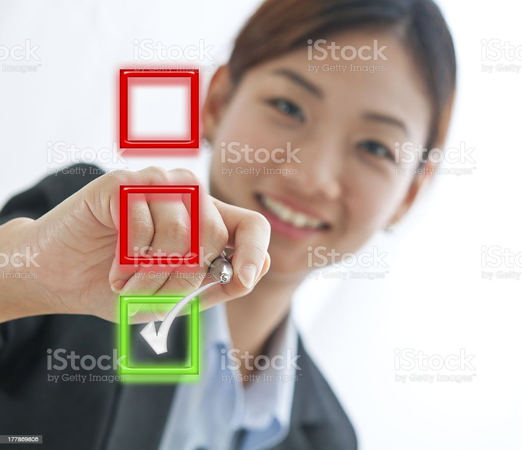 Businesswoman choosing mark the check box isolate on white back stock photo