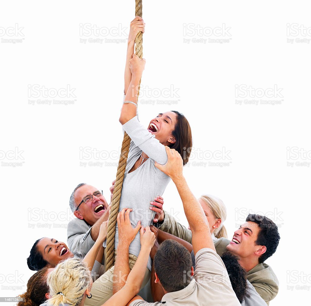 Businesswoman climbing up rope surrounded with colleagues royalty-free stock photo