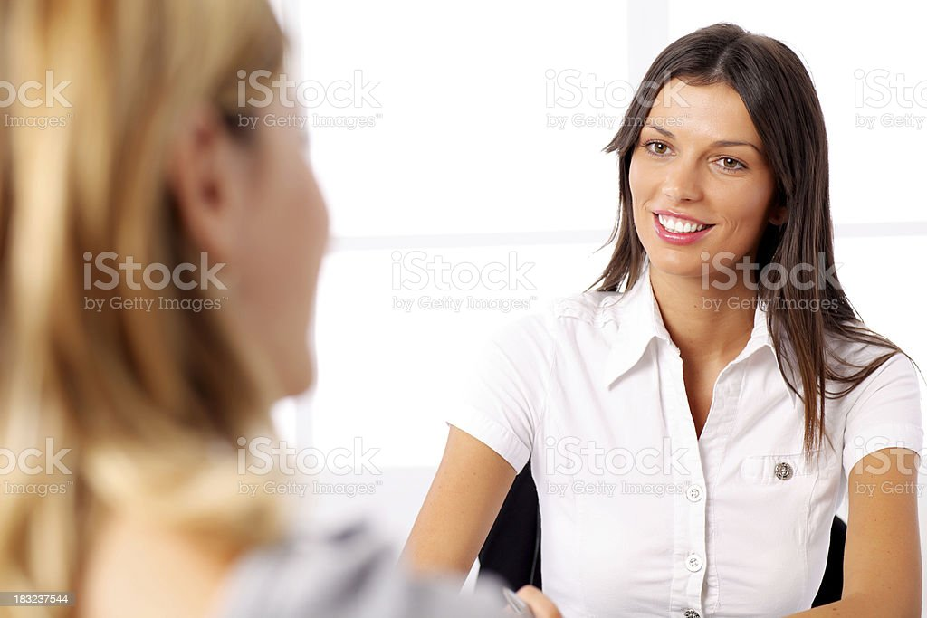 Businesswoman conducting job interview in brightly office. royalty-free stock photo