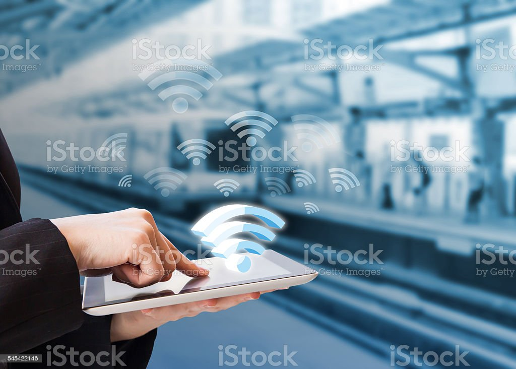 Businesswoman connecting to Wifi stock photo