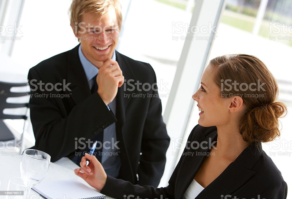 Businesswoman consulting a partner royalty-free stock photo