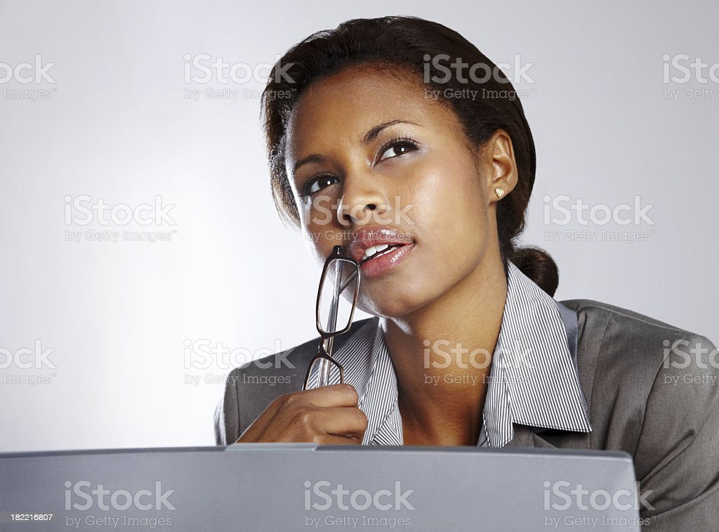 Businesswoman contemplating while working royalty-free stock photo