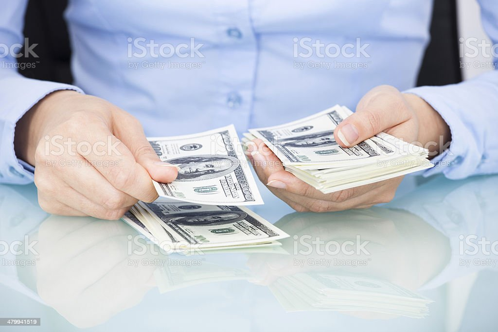 Businesswoman Counting Bank Note stock photo