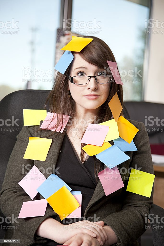 Businesswoman covered with sticky notes royalty-free stock photo
