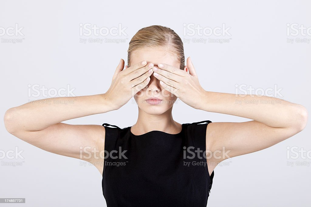 Businesswoman Covering Eyes with Both Hands royalty-free stock photo