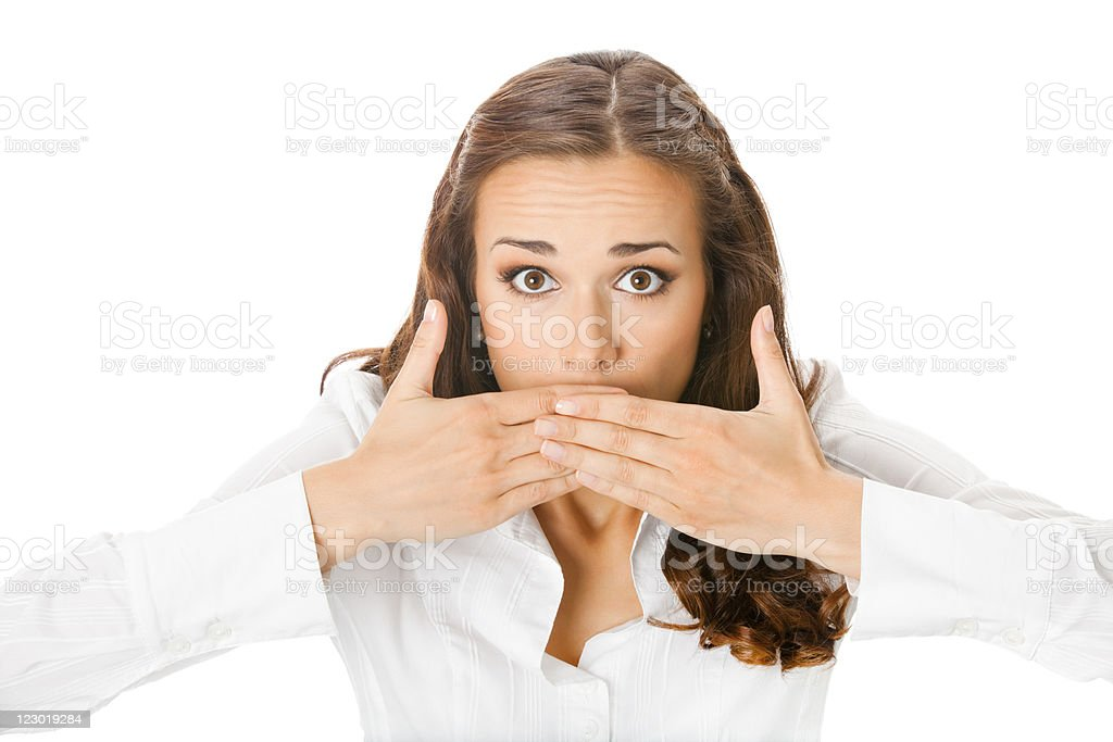 Businesswoman covering with hands her mouth, isolated stock photo