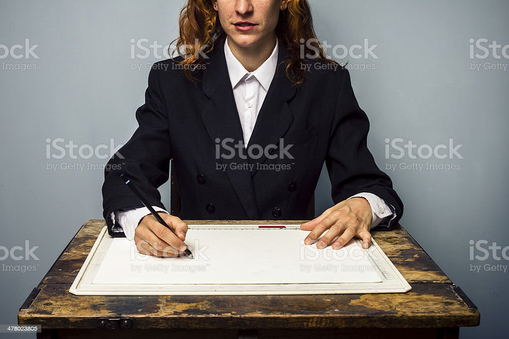 Businesswoman creating designs at drawing board royalty-free stock photo