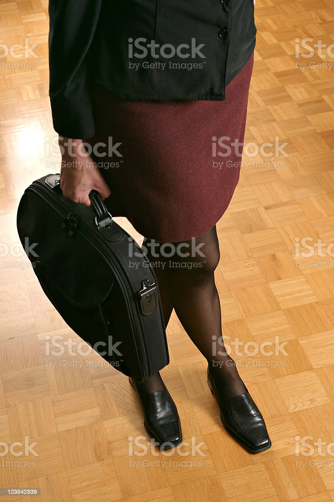 Businesswoman crossing her legs royalty-free stock photo
