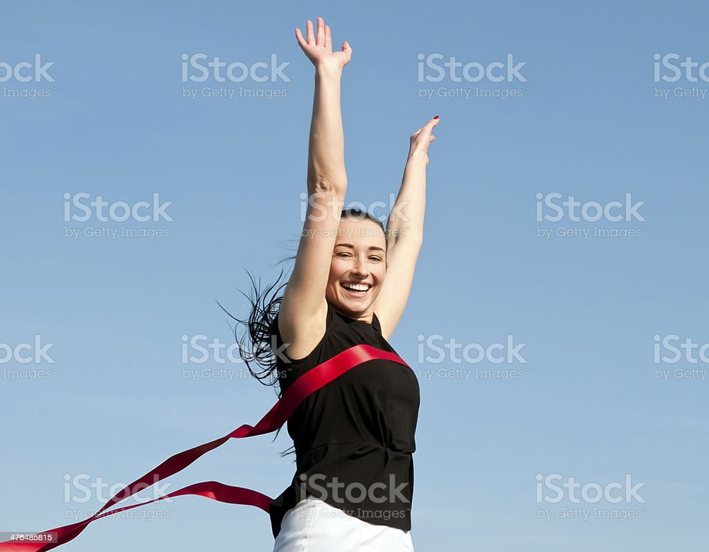 businesswoman crossing the finish line royalty-free stock photo