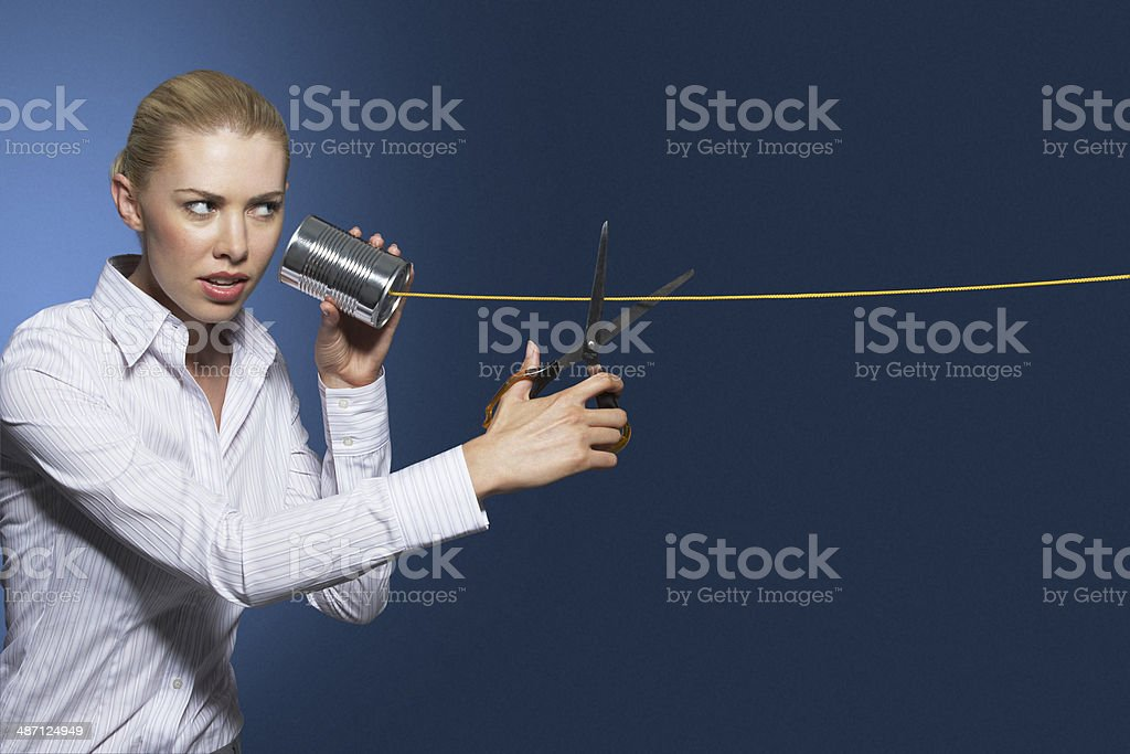 Businesswoman Cutting Line On Tin Can String Phone stock photo