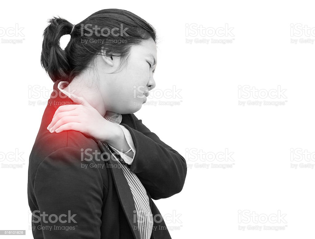 Businesswoman deeply pained on shoulder : Office syndrome effect stock photo