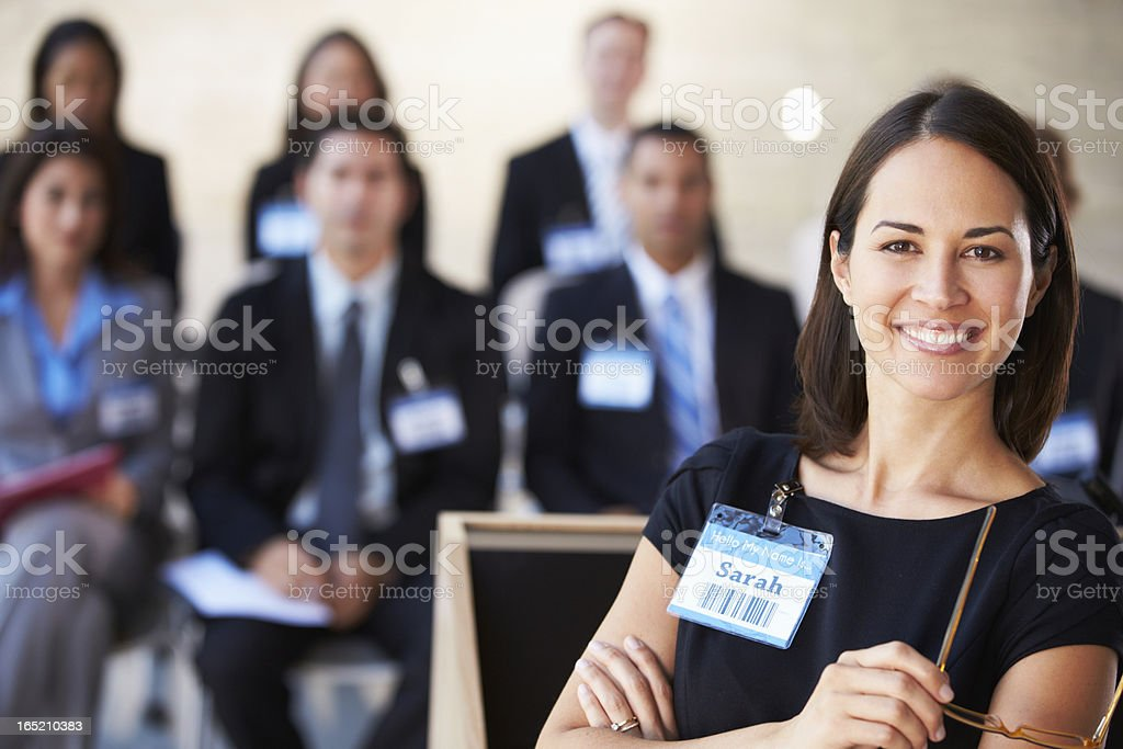 Businesswoman Delivering Presentation At Conference royalty-free stock photo