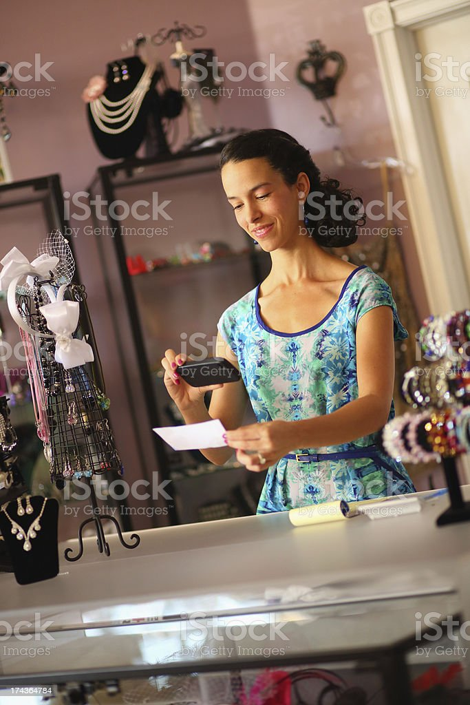 Businesswoman depositing a check with her smartphone royalty-free stock photo